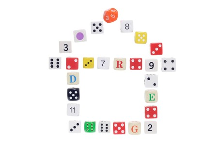 Dice Arranged in Shape of House on White Background Stock Photo - 6971556