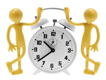 Alarm Clock and Miniature Figures on White Background photo