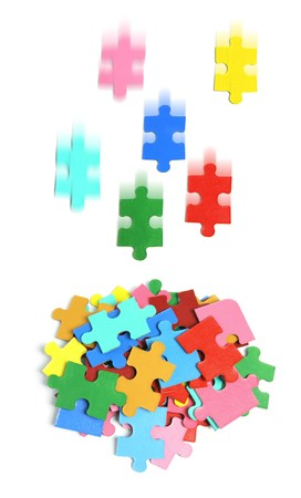 Pile of Jigsaw Puzzle Pieces on White Background photo