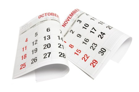 out of date: Pages of Calendar on White Background Stock Photo