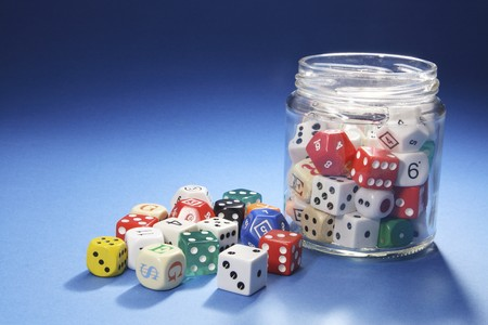 Assorted Dice in Glass Jar on White Background Stock Photo - 7219279