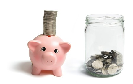 Piggybank and Coins on White Background photo