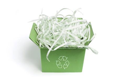 shredded: Box of Paper Shreddings on White Background Stock Photo