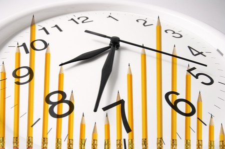 time pressure: Composite of Pencils and Clock Stock Photo