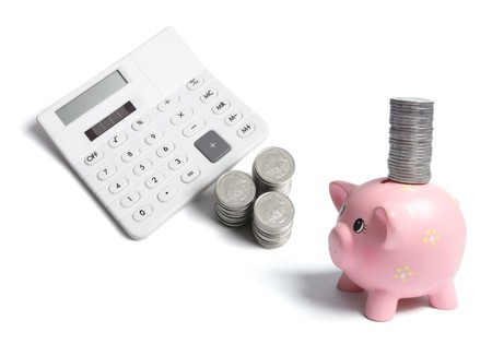 Calculator and Coins on White Background Stock Photo - 7389168