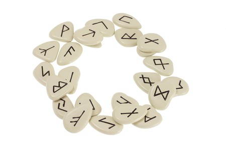 Rune Stones Arranged in Circle on White Background photo