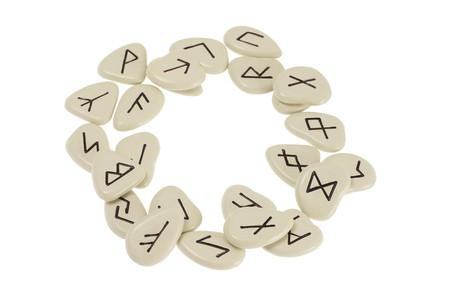Rune Stones Arranged in Circle on White Background photo