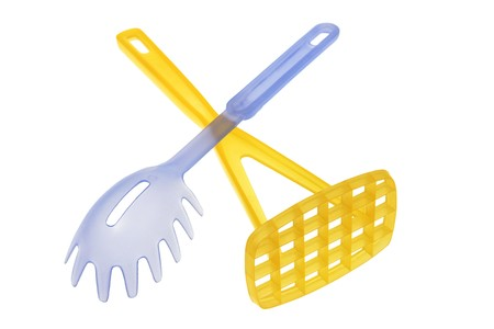 Plastic Spaghetti Server and Potato Masher on White Background photo