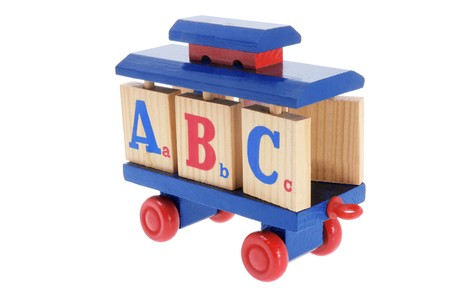 pull along: Toy Train with Alphabet Blocks on White Background Stock Photo