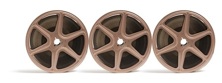 out of production: Movie Film Reels on Isolated White Background