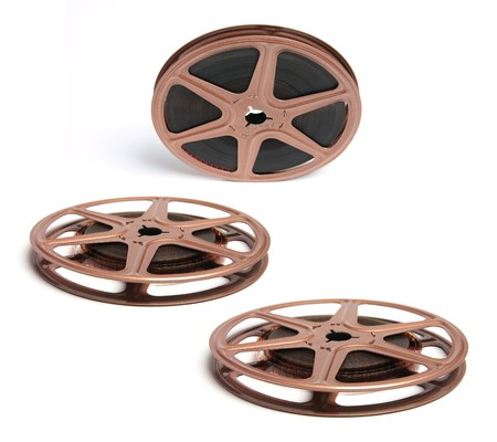 out of production: Movie Film Reels on White Background Stock Photo