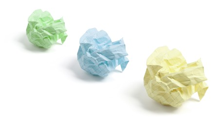 scrunched: Crumpled Paper Balls on White Background