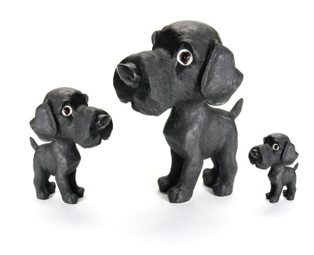 offsprings: Dog Figurines on isolated White Background Stock Photo
