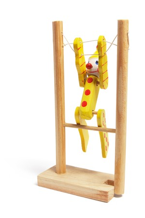 Wooden Toy Gymnast on White Background photo