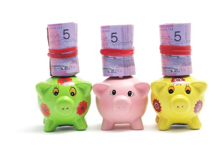 Piggy Banks and Dollar Notes on White Background photo