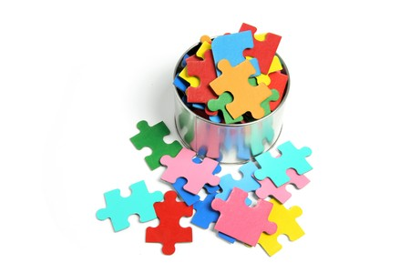 interlink: Jigsaw Puzzle and Tin Can on White Background