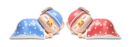 piggybanks: Sleeping Piggybanks on White Background
