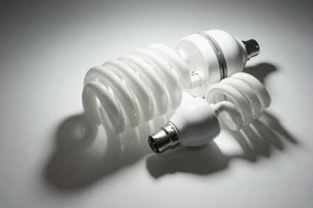 Compact Fluorescent Lightbulbs on Seamless Background Stock Photo - 7826372