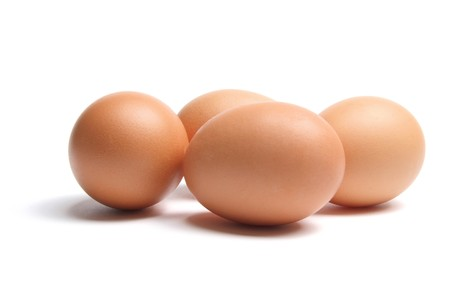 Brown Eggs on White Background photo
