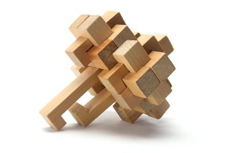 logic: Wooden Brain Teaser on White Background