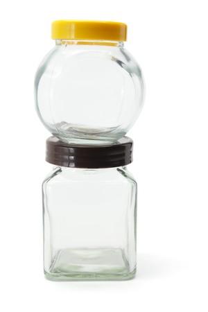 bocaux en verre: Pots de verre sur fond blanc Banque d'images