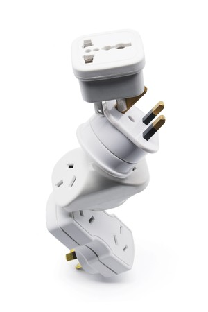 Stack of Power Adaptors on White Background Stock Photo - 7974669