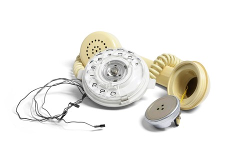 Broken Phone Receiver and Dial on White Background photo