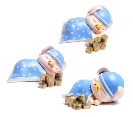 Piggybanks and Stacks of Coins on White Background Stock Photo - 7974719