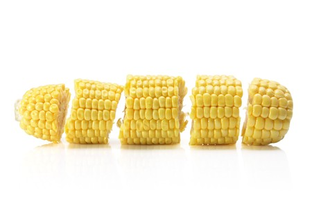 Slices of Corn Cob on White Background photo