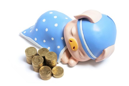 Piggybank and Coins on White Background Stock Photo - 8193589