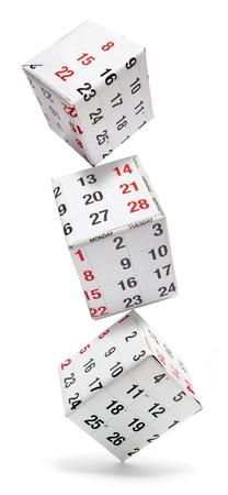 Boîtes avec pages du calendrier sur fond blanc