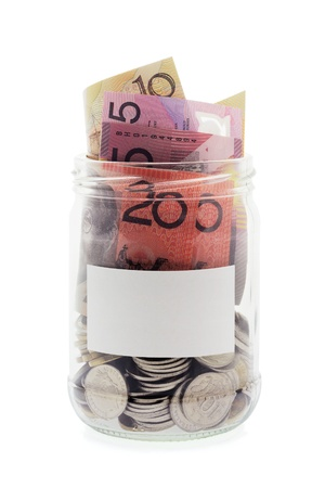 Coins and Banknotes in Glass Jar on White Background photo