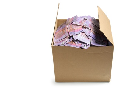 Banknotes in Cardboard Box on White Background photo