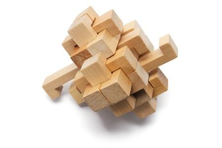 Wooden Brain Teaser on White Background Stock Photo - 8494620