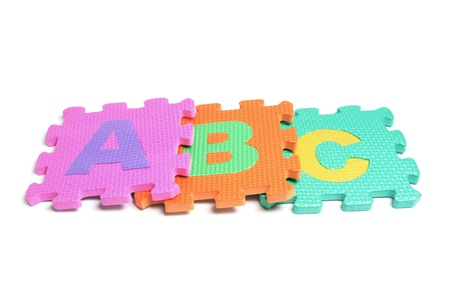 Alphabet Puzzle Pieces on White Background photo