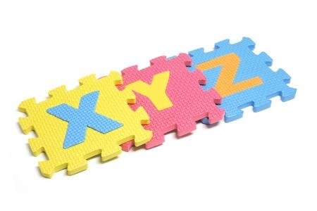 Alphabet Puzzle Pieces on White Background Stock Photo - 8512947