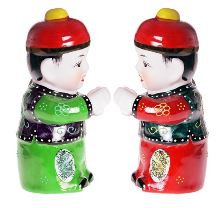 Chinese Boy Figurines on White Background Stock Photo - 8512975