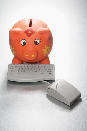 Piggy Bank and Computer Keyboard on Seamless Background photo