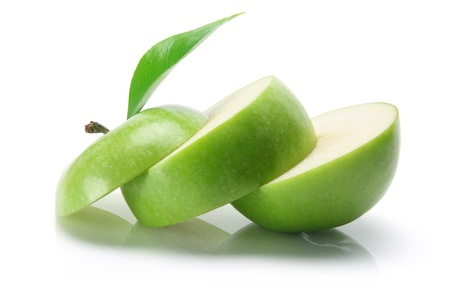 produce sections: Slices of Granny Smith Apple on White Background