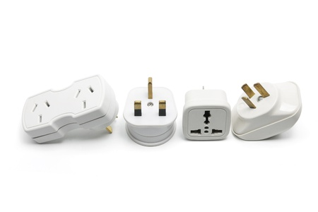 Power Adaptors on White Background photo