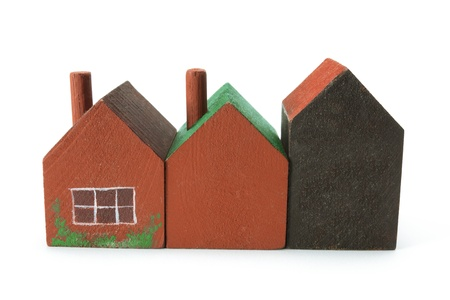 Wooden Miniature Houses on White Background photo