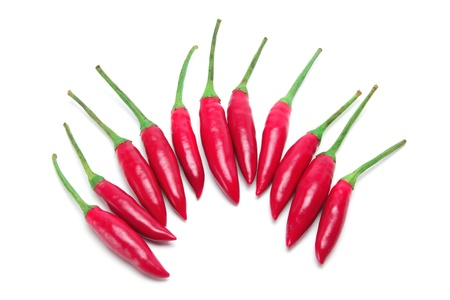 pungency: Red Chillies on White Background