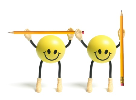 Smiley Toys with Pencils on White Background photo