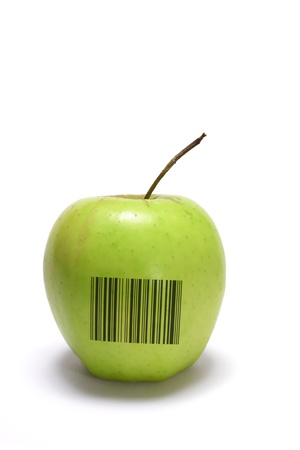 Golden Delicious Apple with Bar Code on White Background  photo