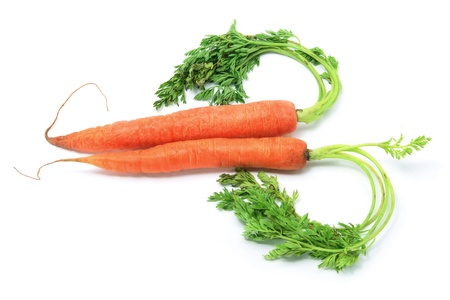 Carrots Arranged in Heart Shape on White Background Stock Photo - 9086802
