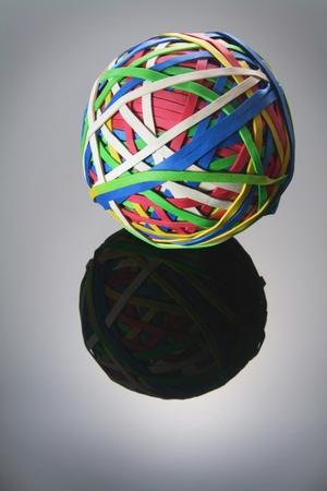 rubberband: Bola de goma sobre fondo gris Foto de archivo