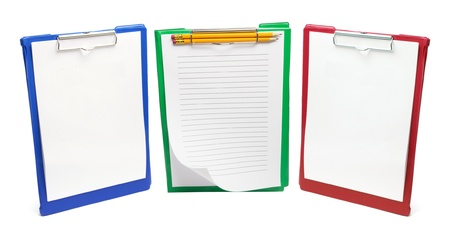 Clipboards with Papers and Pencils on White Background photo