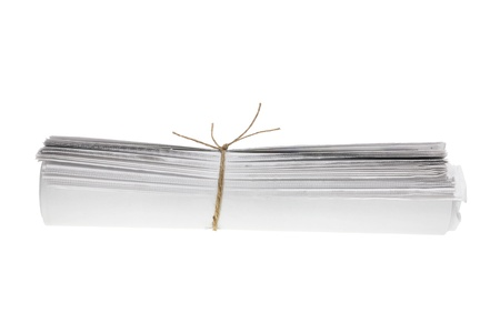 Roll of Newspapers on White Background Stock Photo - 9582626