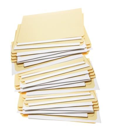 filing document: Stack of Manila Folders on White Background