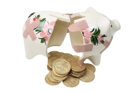 Broken Piggy Bank on White Background Stock Photo - 9660757